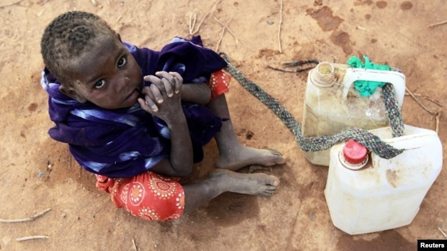 A Somali refugee girl waits for her turn to collect water from a tank at the Ifo extension refugee camp in Dadaab, near the Kenya-Somalia border, July 31, 2011.