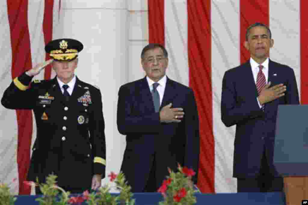 President Barack Obama, right, Defense Secretary Leon Panetta, center, and Chairman of the Joint Chiefs of Staff Gen. Martin Dempsey, stand during the singing of the National Anthem at the Memorial Day Observance at the Memorial Amphitheater at Arlington