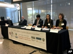 Students from the Sandra Day O'Connor College of Law at Arizona State University offer their recommendations to improve the voting access for Indians, Thursday, Jan. 11, 2018, in Phoenix, Ariz, as part of a hearing by the Native American Voting Rights Coa