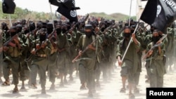 New recruits belonging to Somalia's al-Qaeda-linked al Shabaab rebel group march at a military training base in Afgoye, west of the capital Mogadishu. (file)