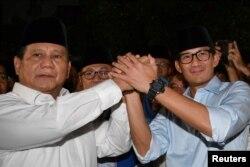 Capres Nomor 02, Prabowo Subianto dan Cawapres Sandiaga Uno (Foto: Reuters).