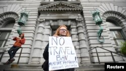 FILE - Beth Kohn protests against U.S. President Donald Trump's executive order outside the 9th U.S. Circuit Court of Appeals courthouse in San Francisco, California, Feb. 7, 2017.