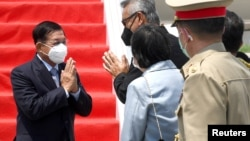 Myanmar's junta chief Senior General Min Aung Hlaing (L) gestures as he is welcomed upon his arrival ahead of the ASEAN leaders' summit, at the Soekarno Hatta International airport in Tangerang, on the outskirts of Jakarta, Indonesia, April 24, 2021. Cour