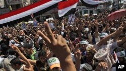 Anti-government protesters shout slogans and gesture during a demonstration demanding the resignation of Yemeni President Ali Abdullah Saleh, in Sana'a, Yemen, February 26, 2011