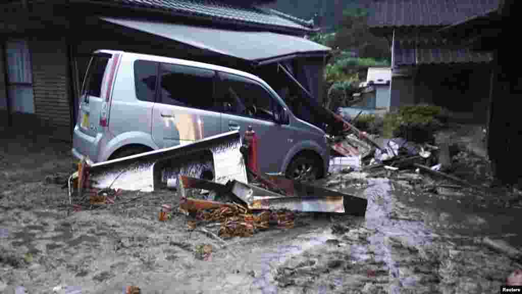 Cars and buildings damaged by a landslide caused by heavy rains set off by Typhoon Neoguri are seen in Nagiso town, Nagano Prefecture, in this photo taken by Nagano Prefecture, July 9, 2014.