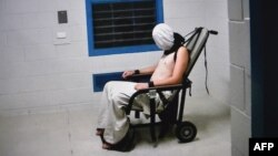 This frame grab from Australian Broadcasting Corporation's (ABC) Four Corners program broadcast in Australia on July 25, 2016 and released on July 26, 2016 allegedly shows a teenage boy hooded and strapped into a chair at a youth detention center in the Northern Territory city of Darwin.