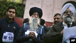 Centenarian Fauja Singh, center, takes part in a running event in Amritsar, India, Sunday, Jan. 22, 2012.