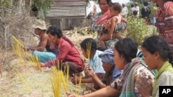A group of villagers lit incense, in Kampong Speu province.