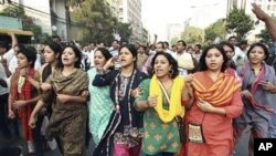 Bangladesh's main opposition Bangladesh Nationalist Party activists shout slogans as they march during a strike in Dhaka, Bangladesh, 14 Nov 2010