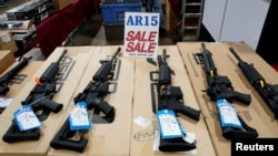 FILE - AR-15 rifles are displayed for sale at a gun show in Pennsylvania, Oct. 6, 2017.