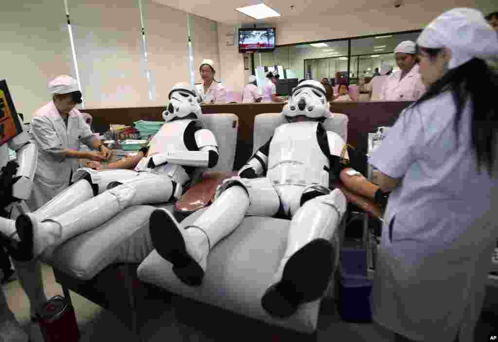 Udomsak Ratanotayo (l) and Suttinan Boonsomkiat wear storm trooper costumes while donating blood at the Thai Red Cross in Bangkok, Thailand. Thai Star Wars fans will donate blood and give toys at an orphanage as part of a promotional campaign.