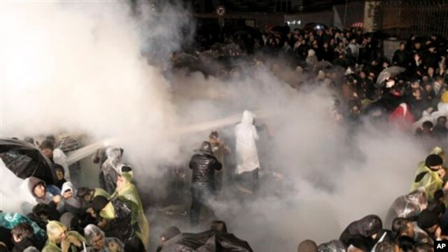 Riot police use tear gas and water cannons against people gathered in support of Turkey's largest-circulation newspaper Zaman at its headquarters in Istanbul, early Saturday, March 5, 2016. The police raid came hours after a court placed it under the management of trustees on Friday. The move against the paper, which is linked to an opposition cleric, heightened concerns over deteriorating press freedoms in the country.
