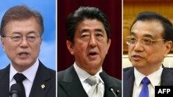 문재인 한국 대통령, 아베 신조 일본 총리와 리커창 중국 국무원 총리.