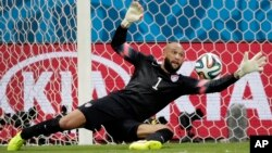United States' goalkeeper Tim Howard, seen in this July 1, 2014 photo, saves a shot by Belgium during a World Cup round of 16 soccer match at the Arena Fonte Nova in Salvador, Brazil.