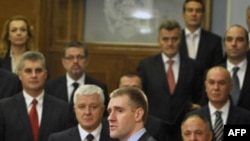 Newly elected Montenegro Prime Minister Igor Luksic, centre, addresses parliament in Podgorica, Montenegro, Wednesday, Dec. 29, 2010.
