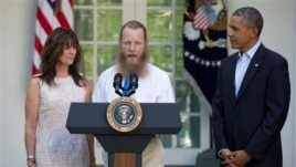 President Barack Obama with Jani Bergdahl and Bob Bergdahl, parents of U.S. Army Sgt. Bowe Bergdahl, in Rose Garden of White House, Washington, May 31, 2014.