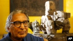 India's Balkrishna Doshi who won the 2018 Pritzker Architecture Prize sits for a photo at his home in Ahmadabad, India, Wednesday, March 7, 2018. (AP Photo/Ajit Solanki)