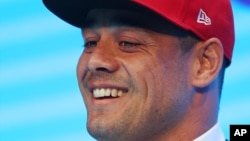 Jarryd Hayne smiles as he announces his free agent contract with the National Football League team the San Francisco 49ers at a press conference in Sydney, Tuesday, March 3, 2015.