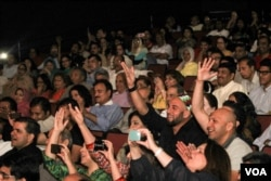 FILE - An audience cheers at a Qawwali concert by Amjad Sabri in Annandale, Virginia, in 2013. Qawwali music received international exposure through the work of the late Pakistani artists Nusrat Fateh Ali Khan, Aziz Mian Qawwal and the Sabri Brothers. After these musicians passed away in the late 1990s, Amjad Sabri (the son of Ghulam Farid Sabri of the Sabri Brothers) stepped into his father's shoes at age 12 and made his own following all over the world. (Saqib Ul Islam/VOA)