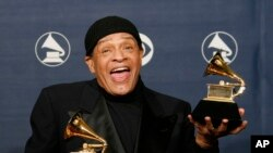 "FILE - In this Sunday, Feb. 11, 2007, file photo, Al Jarreau poses with his awards for best pop instrumental performance for ""Mornin'"" and best traditional R&B vocal performance for ""God Bless the Child"" at the 49th Annual Grammy Awards in Los Angeles. Jarreau died in a Los Angeles hospital early Sunday, Feb. 12, 2017, according to his official Twitter account and website."