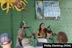 Musicians Emily Miller and her husband Jesse Milnes perform at the Augusta Heritage Music Festival in Elkins, West Virginia.