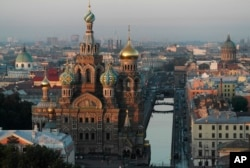 The Savior of Spilled Blood Cathedral is seen in St.Petersburg, Russia, Monday, July 29, 2013, with the Griboyedov canal at right. (AP Photo/Dmitry Lovetsky)