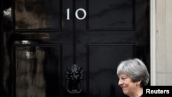 FILE - Britain's Prime Minister Theresa May walks out of 10 Downing Street in London, Jan. 30, 2018.