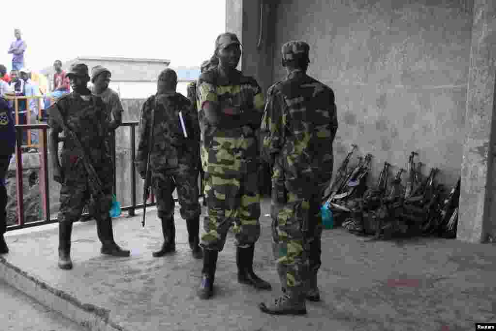 M23 rebels guard weapons given to them by the government's army, Goma, DRC, November 21, 2012.