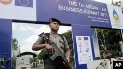 An armed police officer stands guard outside the venue of the 18th ASEAN Summit - will be held on May 7-8 in Jakarta, Indonesia, May 4, 2011.