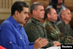 Venezuela's President Nicolas Maduro speaks during a broadcast with members of the government and military high command members at Miraflores Palace in Caracas, Apr. 30, 2019. (Miraflores Palace handout)