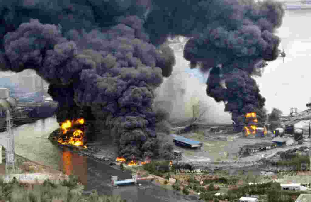 A factory facility burns following an earthquake and tsunami in Sendai, northeastern Japan March 12, 2011. Japan confronted devastation along its northeastern coast on Saturday, with fires raging and parts of some cities under water after a massive earthq