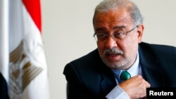 FILE - Egypt's Petroleum Minister Sherif Ismail talks during an interview with Reuters on investments undertaken by his country, at his office in Cairo, Sept. 22, 2014.