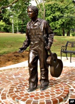 Sculptor Michiel Van der Sommen created this life-size bronze statue, in Tupelo, of Elvis at about age 13