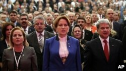 FILE - Meral Aksener, a former interior minister and deputy parliament speaker, center, attends her party's first meeting in Ankara, Turkey, Oct. 25, 2017.