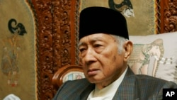 FILE - Former Indonesian dictator Suharto sits in his home in Jakarta, Oct. 24. 2006.