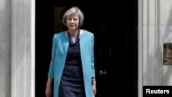 FILE - Britain's Home Secretary, Theresa May, leaves after a cabinet meeting in Downing Street in central London, Britain, June 27, 2016.