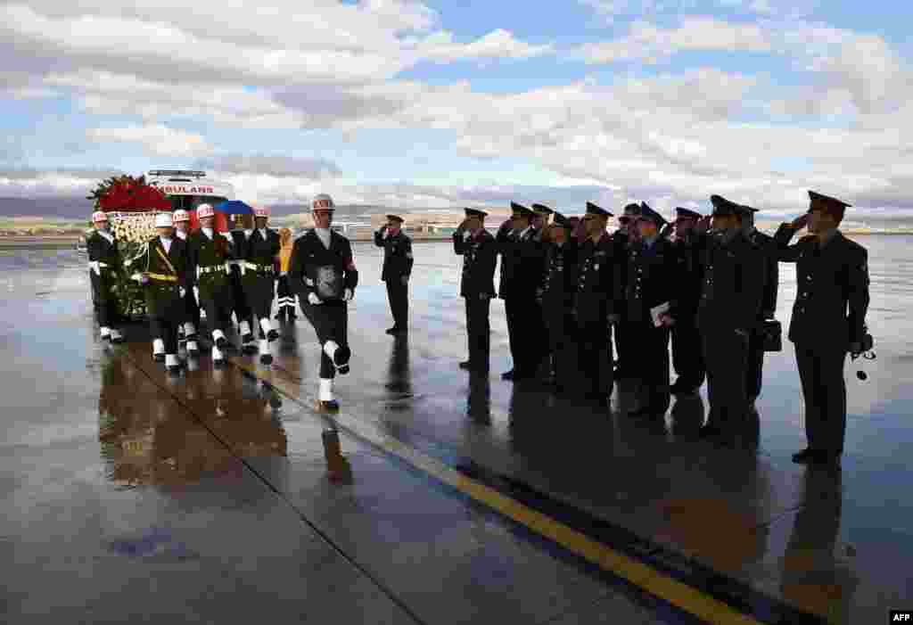 A picture released by Turkish army press office shows Turkish soldiers carrying the coffin of Russian pilot Lt. Col. Oleg Peshkov into a Russian Air Force transport during a ceremony at Esenboga Airport in Ankara. Ankara sent back to Russia the body of a pilot killed when his plane was shot down by the Turkish air force for allegedly violating its air space on the Syrian border.