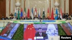 中國國家領導人習近平在塔吉克斯坦杜尚別舉行的上海合作組織峰會上通過視頻發表講話。 (2021年9月17日)