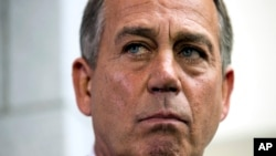 Speaker of the House John Boehner, R- Ohio, pauses during a news conference after a House Republican Conference meeting, Sept. 30, 2013.