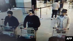 "A screengrab of airport CCTV footage released by Belgian federal police shows suspects in the attacks at Brussels Airport, in Zaventem, March 22, 2016. Police is seeking help in identifying the ""man in the hat"" on the right."
