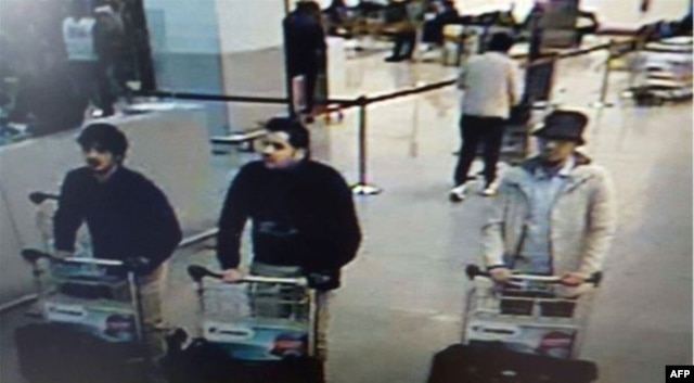 Photo released by Belgian federal police on demand of Federal prosecutor shows screengrab of airport CCTV camera showing suspects of this morning's attacks at Brussels Airport, in Zaventem, March 22, 2016.