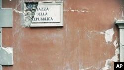 Rubble lies on the ground beside a postbox in the Piazza della Repubblica in Central L'aquila (January 2010 file photo)