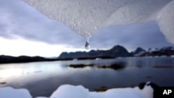 FILE - An iceberg melts near the Arctic Circle, Kulusuk, Greenland.