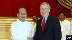 President Thein Sein, left, welcomes U.S. Senate Republican leader Mitch McConnell at the presidential palace Tuesday, Jan. 17, 2012 in Naypyitaw, Myanmar.