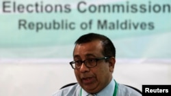 FILE - Maldives Election Commissioner Fuwad Thowfeek speaks during a news conference in Male, October 18, 2013.