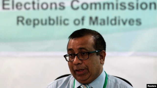 FILE - Maldives Election Commissioner Fuwad Thowfeek speaks during a news conference in Male, Oct. 18, 2013.