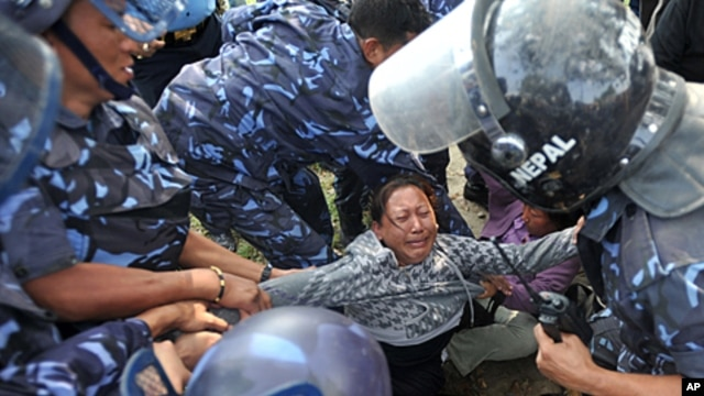 Nepalese riot police arrest Tibetan protesters near the Jwalakhel Refugee Camp in Kathmandu, November 1, 2011.