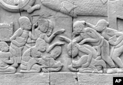 FILE - The old pastime of cockfighting still beguiles enthusiasts in the reliefs carved centuries ago on the walls of the Angkor Wat in Cambodia.