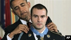 President Barack Obama presents the Medal of Honor to Staff Sgt. Salvatore Giunta, who rescued two members of his squad in October 2007 while fighting in Afghanistan, 16 Nov 2010, at the White House