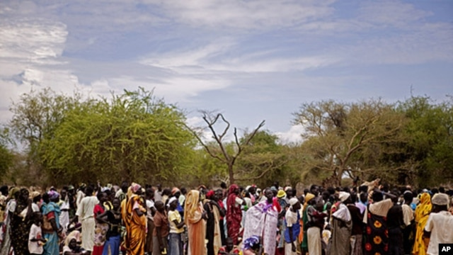 Women line up for food distribution in a makeshift camp for internally displaced people in the village of Mayen Abun, southern Sudan,  May 26, 2011